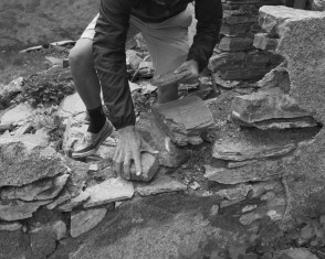 Jonathan Hero Constructing a Cairn For Faustino